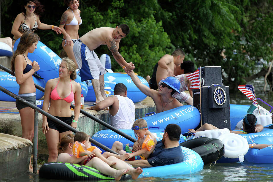 Tubers exit the Comal River by Prince Solms Park in New Braunfels, Sunday, May 26, 2013. The Memorial Day weekend marks the start of the tubing season on the Comal and Guadalupe Rivers. Photo: San Antonio Express-News / ©2013 San Antonio Express-News