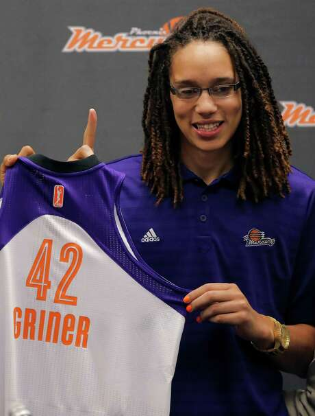 Phoenix Mercury's Brittney Griner, the No. 1 overall pick the WNBA draft, holds a team jersey during a news conference Saturday, April 20, 2013,  in Phoenix. (AP Photo/Matt York) Photo: Matt York, STF / AP