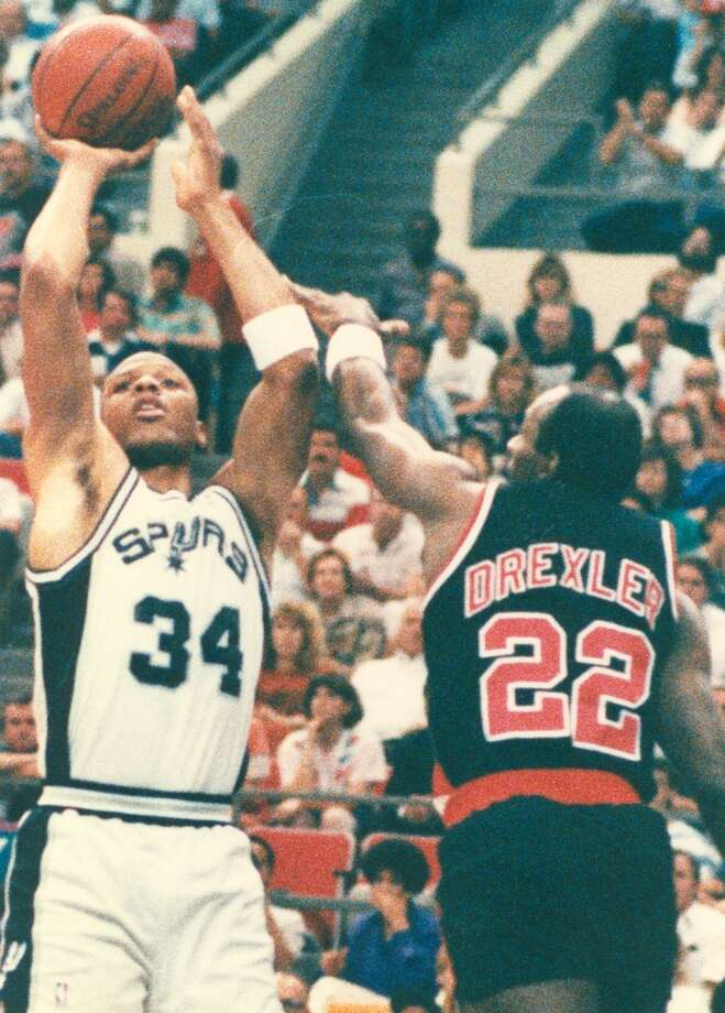 1989-90 - Portland, first round, 3-0. The Spurs' Terry Cummings (left) shoots over the Trail Blazers' Clyde Drexller during Game 3 of series. The Spurs won 121-98.