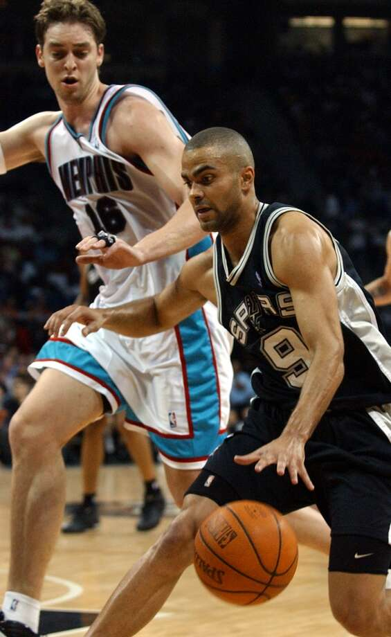 2003-04 - Memphis, first round, 4-0.   The Spurs' Tony Parker drives aorund the Grizzlies' Pau Gasol on April 25, 2004 during Game 4 at the Pyramid in Memphis. The Spurs won  110-97.