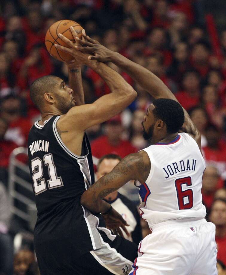 2011-12 - L.A. Clippers, conference semifinals, 4-0 - The Spurs' Tim Duncan (21) takes a shot against the Clippers' DeAndre Jordan (6) in Game 4 of the Western Conference semifinals at Staples Center in Los Angeles on May 20, 2012.