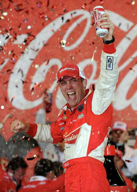 Kevin Harvick toasts his victory in Sunday night's Coca-Cola 600 at Charlotte Motor Speedway. Photo: Jared C. Tilton, Stringer / 2013 Getty Images
