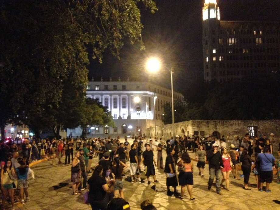 "About 300 people, 20 police and a handful of protestors gathered in front of the Alamo in anticipation of Kanye West's new video, ""New Slaves,"" being projected on the shrine Sunday night (Benjamin Olivo / mySA.com)"