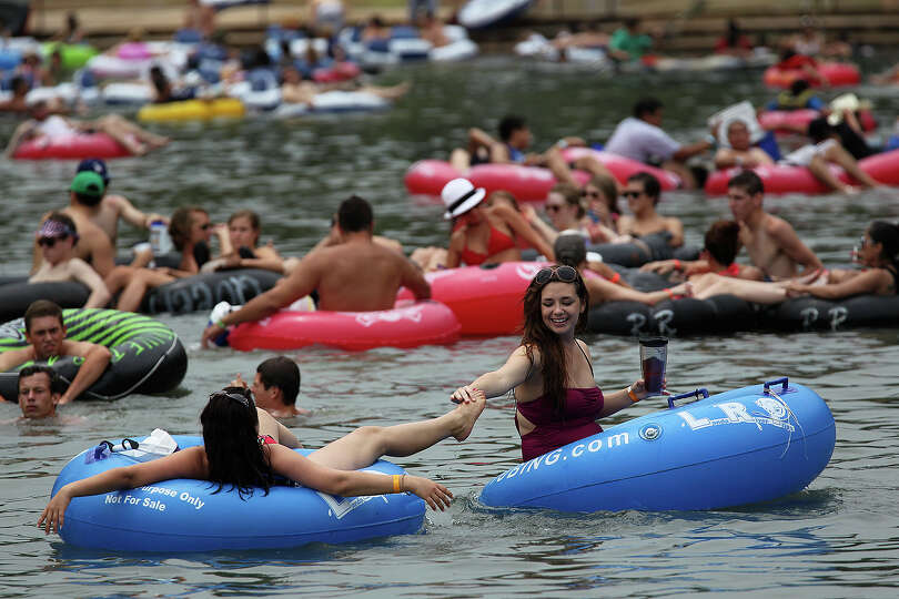 Tubers float down the Comal River by Prince Solms Park in New Braunfels, Sunday, May 26, 2013. Th