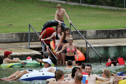 People lines up to get into the Comal River in New Braunfels, Sunday, May 26, 2013. The Memorial Day weekend marks the start of tubing season on the Comal and Guadalupe Rivers. Photo: San Antonio Express-News / ©2013 San Antonio Express-News
