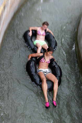 Tubers hit the chute on the Comal River at Prince Solms Park in New Braunfels, Sunday, May 26, 2013. The Memorial Day weekend marks the start of the tubing season on Comal and Guadalupe Rivers. Photo: San Antonio Express-News / ©2013 San Antonio Express-News
