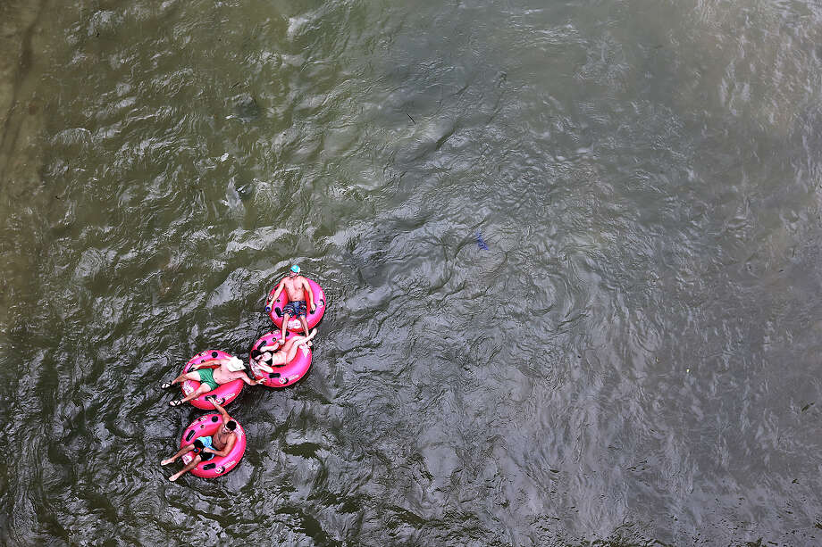 Tubers float down the Comal River in New Braunfels, Sunday, May 26, 2013. The Memorial Day weekend marks the start of the tubing season on the Comal and Guadalupe Rivers. Photo: San Antonio Express-News / ©2013 San Antonio Express-News