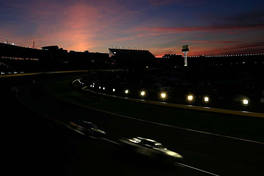 CONCORD, NC - MAY 26:  Cars race as the sunsets during the NASCAR Sprint Cup Series Coca-Cola 600 at Charlotte Motor Speedway on May 26, 2013 in Concord, North Carolina.  (Photo by Jamie Squire/Getty Images) Photo: Jamie Squire, Getty Images