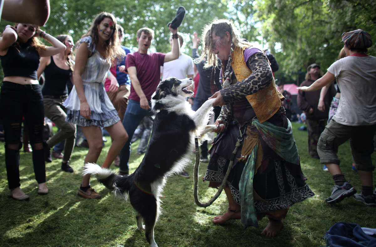 Jennaveave Edmondson dances with her pup, Jedi Master, as they listen to tunes from the band Alder Street during the Northwest Folklife Festival at the Seattle Center on Sunday, May 26, 2013.