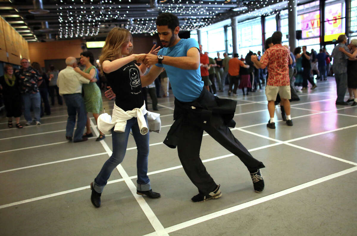 Za Thomaier and Yuliya Dudyshyn dance in Fisher Pavilion during the Northwest Folklife Festival.