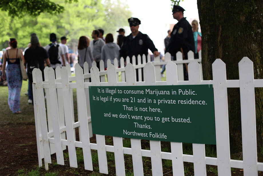 A sign warns people not to smoke marijuana in public during the Northwest Folklife Festival. Photo: JOSHUA TRUJILLO, SEATTLEPI.COM / SEATTLEPI.COM