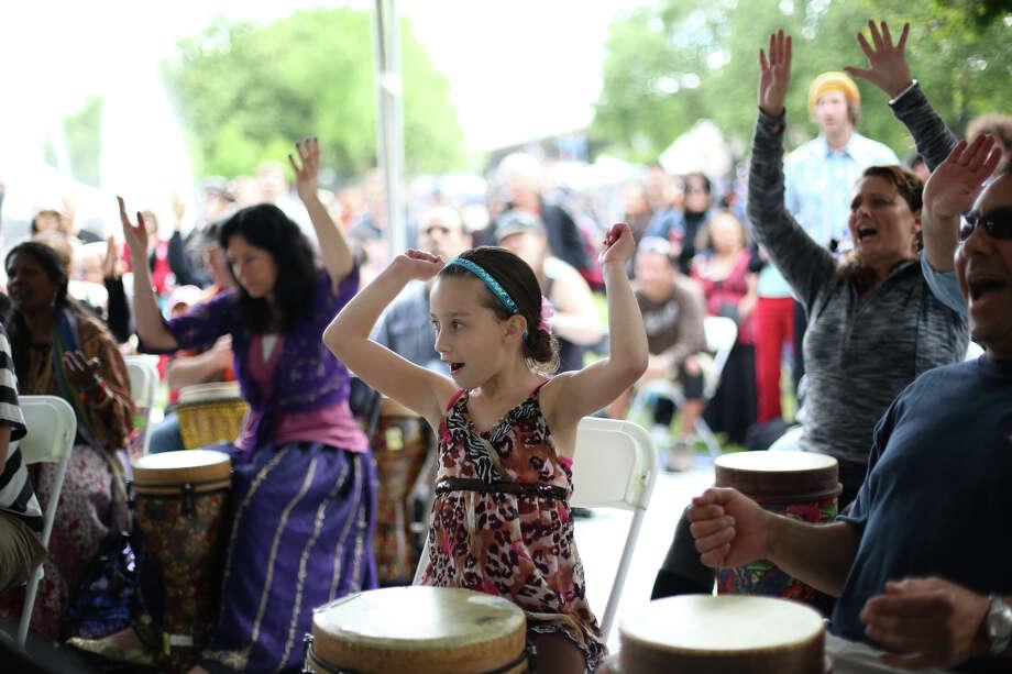 People participate in a drum circle. Photo: JOSHUA TRUJILLO, SEATTLEPI.COM / SEATTLEPI.COM