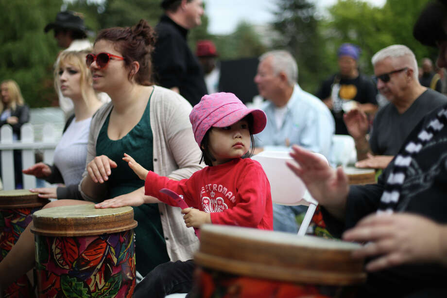 A young drummer participates in a drum circle. Photo: JOSHUA TRUJILLO, SEATTLEPI.COM / SEATTLEPI.COM