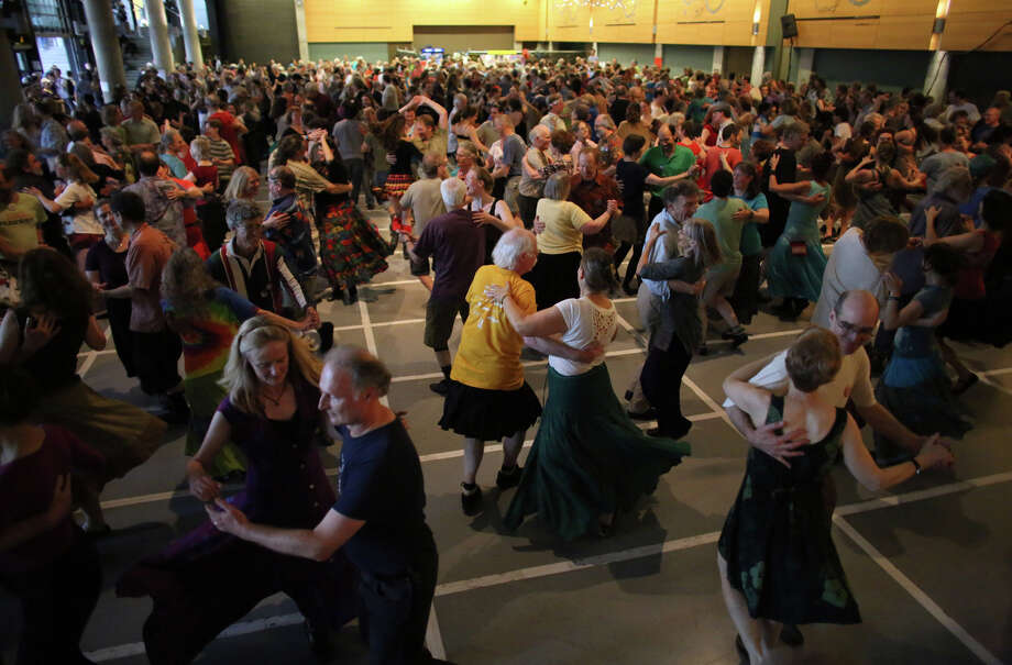 People participate in a contra dance in Fisher Pavilion. Photo: JOSHUA TRUJILLO, SEATTLEPI.COM / SEATTLEPI.COM
