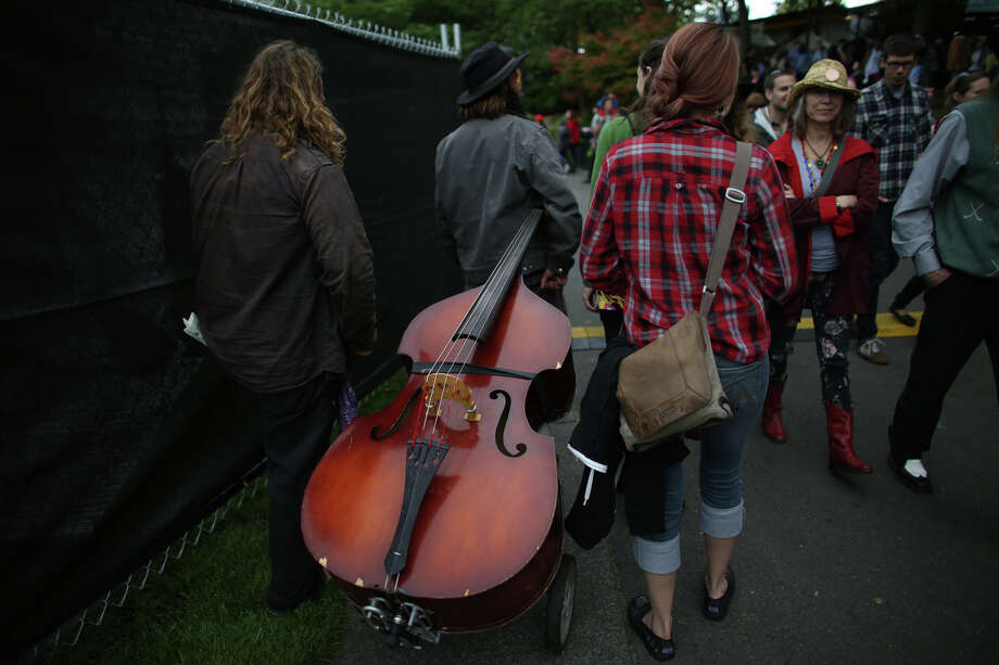 A cello is wheeled through the crowd. Photo: JOSHUA TRUJILLO, SEATTLEPI.COM / SEATTLEPI.COM