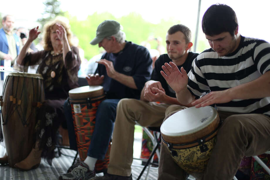 People participate in a drum circle during the Northwest Folklife Festival. Photo: JOSHUA TRUJILLO, SEATTLEPI.COM / SEATTLEPI.COM