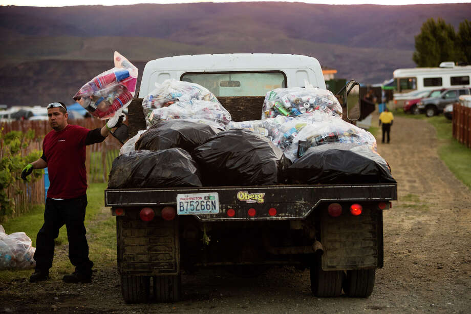 Workers clear the campsites of thousands of bags of beer cans and other trash on the third day of the annual Sasquatch music festival Sunday, May 26, 2013, at The Gorge Amphitheatre in George. Photo: JORDAN STEAD, SEATTLEPI.COM / SEATTLEPI.COM