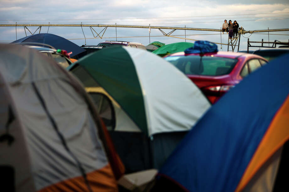 Campers watch the sunset from the heights of a piece of farming machinery on the third day of the annual Sasquatch music festival Sunday, May 26, 2013, at The Gorge Amphitheatre in George. Photo: JORDAN STEAD, SEATTLEPI.COM / SEATTLEPI.COM