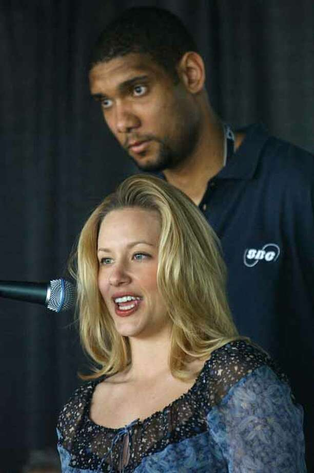 The Spurs' Tim Duncan and his wife, Amy, talk Wednesday afternoon March 26, 2003 during a press conference about the Tim Duncan ArtBall program benefiting the Brighton School, Inc. (WILLIAM LUTHER/STAFF) Photo: WILLIAM LUTHER, SAN ANTONIO EXPRESS-NEWS / SAN ANTONIO EXPRESS-NEWS