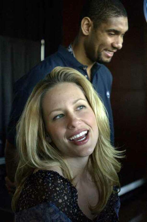 The Spurs' Tim Duncan and his wife, Amy, talk Wednesday afternoon March 27, 2003 during a press conference about the Tim Duncan ArtBall program benefiting the Brighton School, Inc. (WILLIAM LUTHER/STAFF) Photo: WILLIAM LUTHER, SAN ANTONIO EXPRESS-NEWS / SAN ANTONIO EXPRESS-NEWS