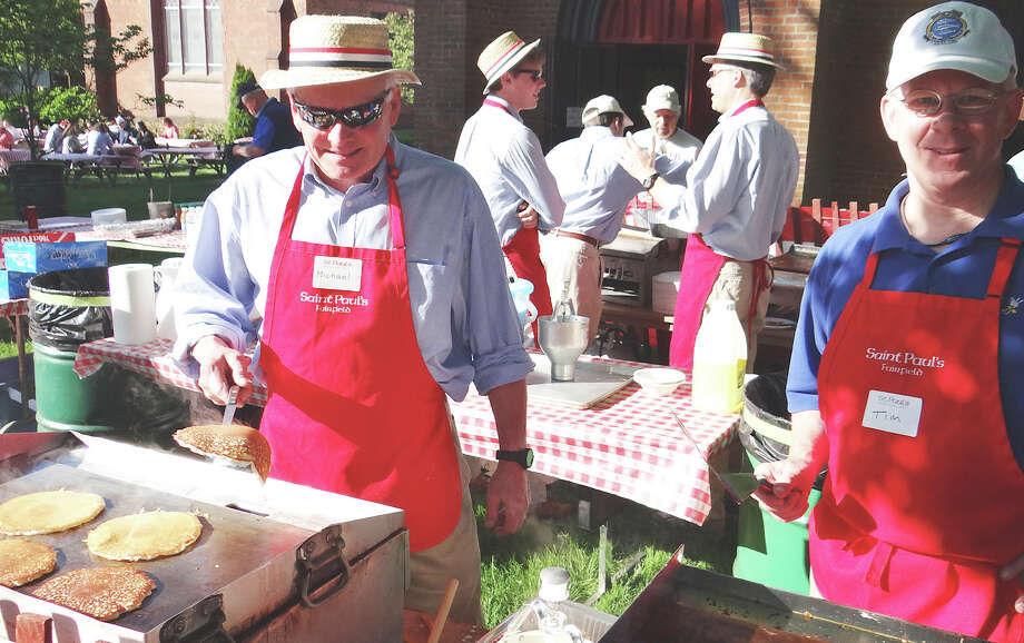 Michael Jerrild and Tim Barney cook up flapjacks at Saint Paul Church's Memorial Day Pancake Breakfast on Monday.    FAIRFIELD CTIZEN, CT 5/27/13 Photo: Mike Lauterborn / Fairfield Citizen contributed