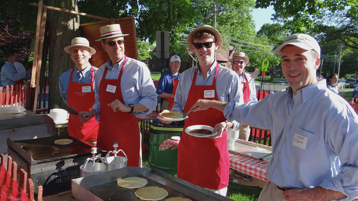 Serving the traditional pancake and sausage Memorial Day breakfast at St. Paul's Episcopal Church on Monday were Dave Haas, Rick Brown, Reid Andren and Matt Wiant. FAIRFIELD CITIZEN, CT 5/27/13