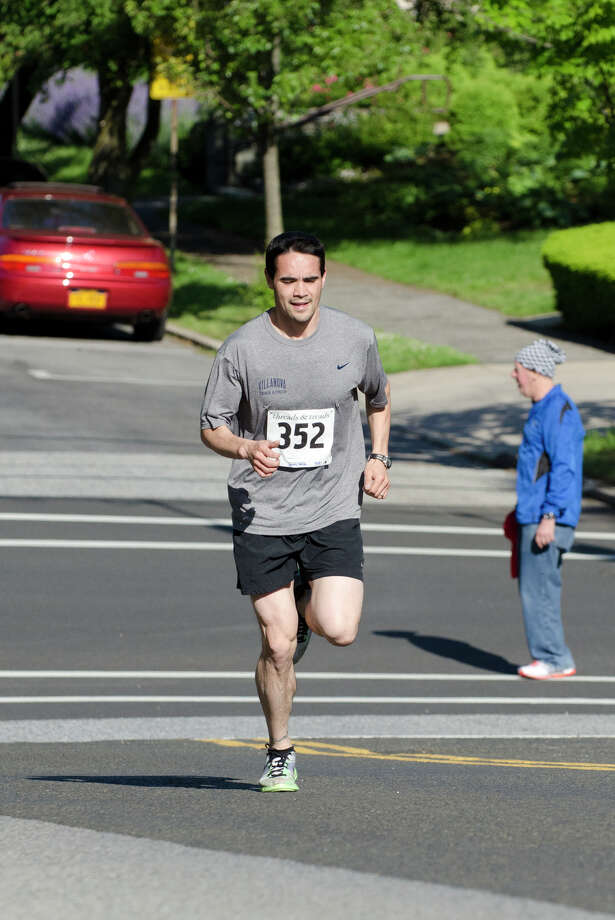 James Osborn, 34, Ridgefield, 26:37, races through Greenwich during the annual Jim Fixx Run, a five-mile road race, in Greenwich on Monday, May 27, 2013. Photo: Amy Mortensen / Connecticut Post Freelance