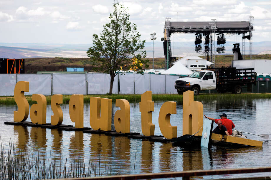 Event staff erect the fallen entrance sign on the third day of the annual Sasquatch music festival Sunday, May 26, 2013, at The Gorge Amphitheatre in George. Photo: JORDAN STEAD, SEATTLEPI.COM / SEATTLEPI.COM