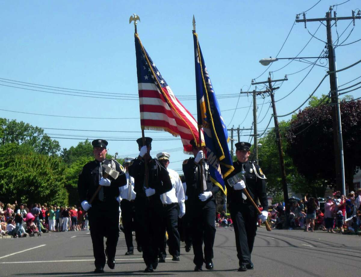 Volunteer fire fighters near the end of the Memorial Day Parade which ended at the Spring Grove Cemetary where the Memorial Day Ceremony took place.