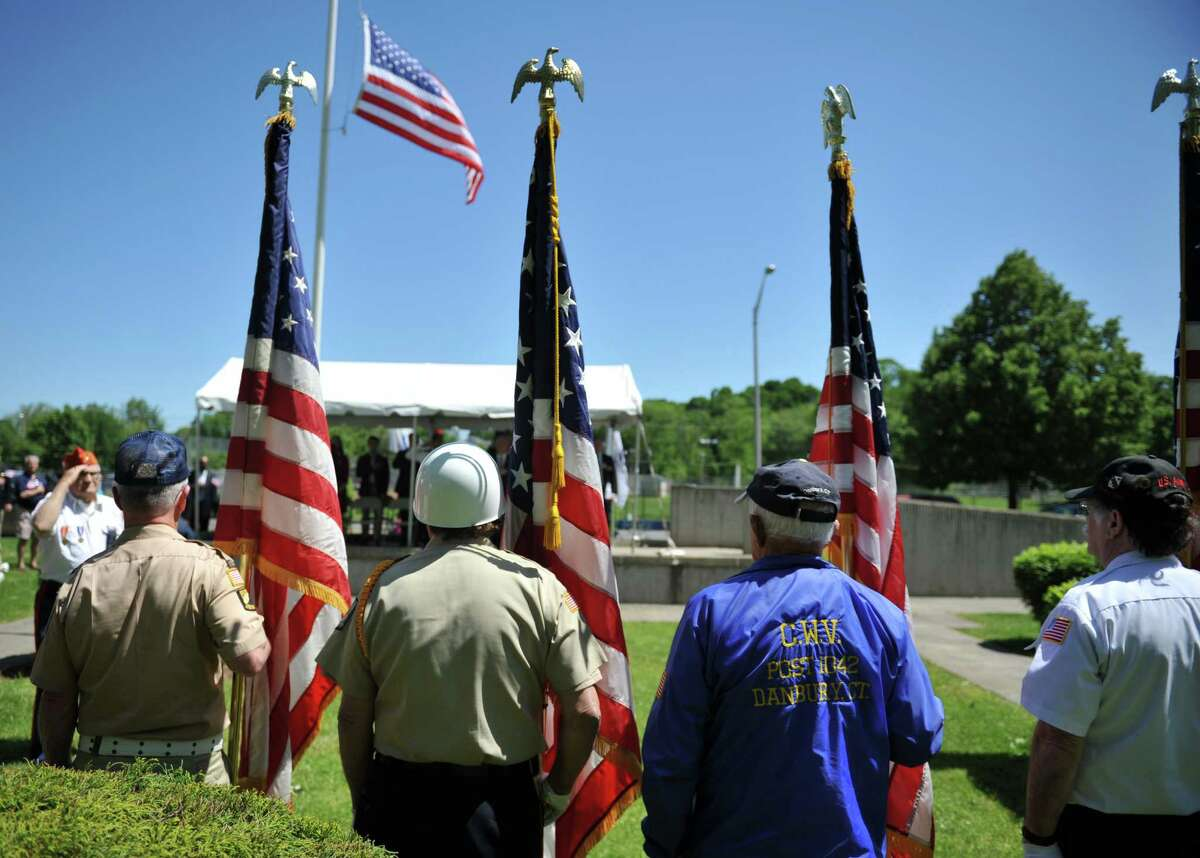 The color guard performs a routine during the Danbury Memorial Day service at the Rogers Park Rose Memorial Garden in Danbury, Conn. on Monday, May 27, 2013.