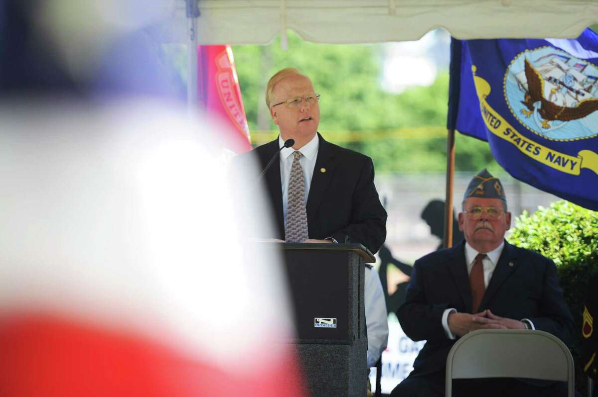 Brookfield Police Chief Robin Montgomery speaks at the Memorial Day service at the Rogers Park Rose Memorial Garden in Danbury, Conn. on Monday, May 27, 2013.