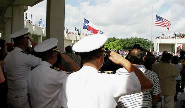 United States Navy members salute during the National Anthem at the Houston National Cemetery Memorial Day Service Monday, May 27, 2013, in Houston. Photo: James Nielsen, Houston Chronicle / © 2013  Houston Chronicle