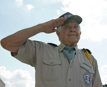 Korean War Veterans Texas Lone Star Chapter's Max Johnson salutes during the Presentation of the Colors during the Houston National Cemetery Memorial Day Service Monday, May 27, 2013, in Houston. Photo: James Nielsen, Houston Chronicle / © 2013  Houston Chronicle