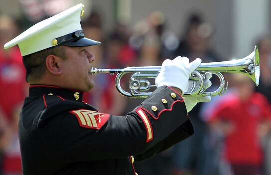 United States Marine Sergeant Mark Collado plays Taps during the Houston National Cemetery Memorial Day Service Monday, May 27, 2013, in Houston. Photo: James Nielsen, Houston Chronicle / © 2013  Houston Chronicle