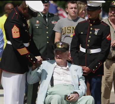 United States Marine Sergeant Major Ramon Nash left, shakes hands with with WWII Army Air Corp veteran Charles Bannon center, as Marine Lance Corporal Chavez right, looks on during the Houston National Cemetery Memorial Day Service Monday, May 27, 2013, in Houston. Photo: James Nielsen, Houston Chronicle / © 2013  Houston Chronicle