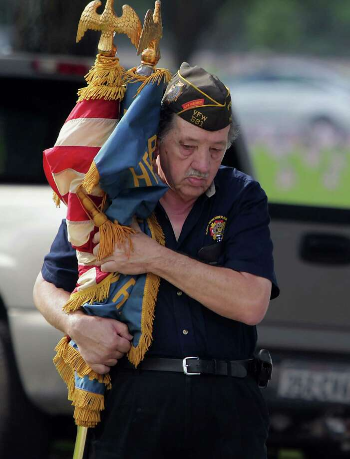 Bert Warnken with VFW Post 581 carries a United States flag and VFW Post flag prior to the Houston National Cemetery Memorial Day Service Monday, May 27, 2013, in Houston. Photo: James Nielsen, Houston Chronicle / © 2013  Houston Chronicle