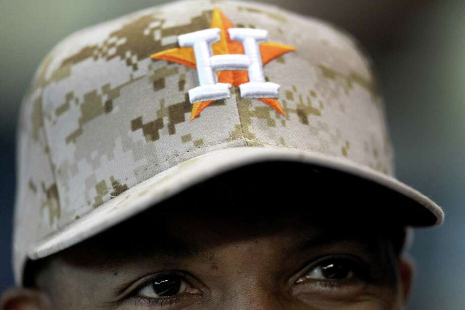 Houston Astros manager Bo Porter (16) wears a camo-style baseball cap in honor of Memorial Day during the first inning of an MLB game at Minute Maid Park, Monday, May 27, 2013, in Houston. Photo: Karen Warren, Houston Chronicle / © 2013 Houston Chronicle