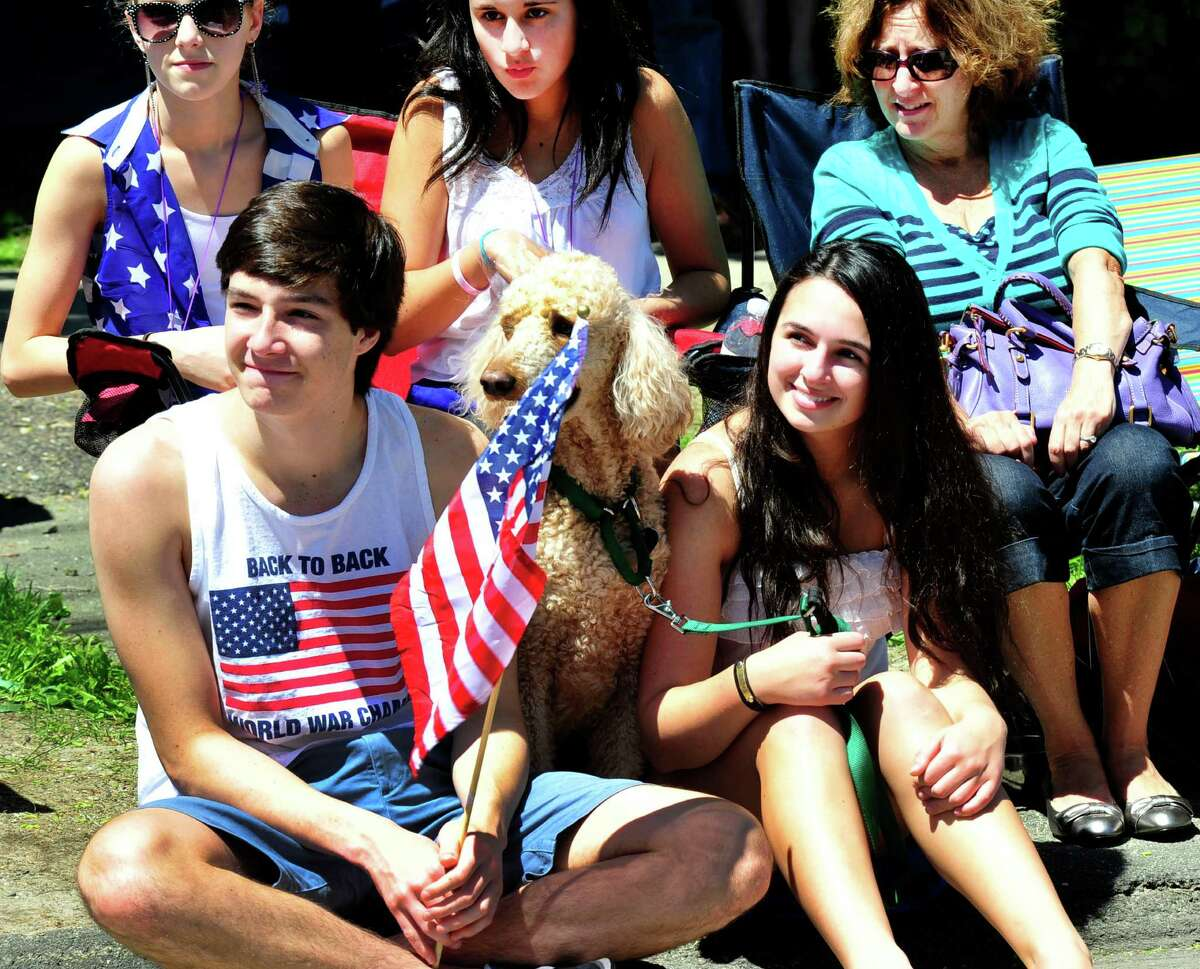 Onlookers enjoy themselves as they watch the annual Memorial Day parade in Ridgefield, Conn. Monday, May 27, 2013.