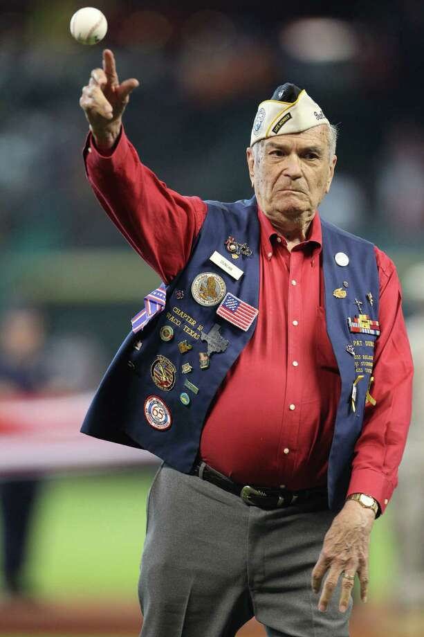 WWII veteran Pat Duncan, 90,  throws out the first pitch during pre-game Memorial Day ceremonies before the start of an MLB game at Minute Maid Park, Monday, May 27, 2013, in Houston. Photo: Karen Warren, Houston Chronicle / © 2013 Houston Chronicle