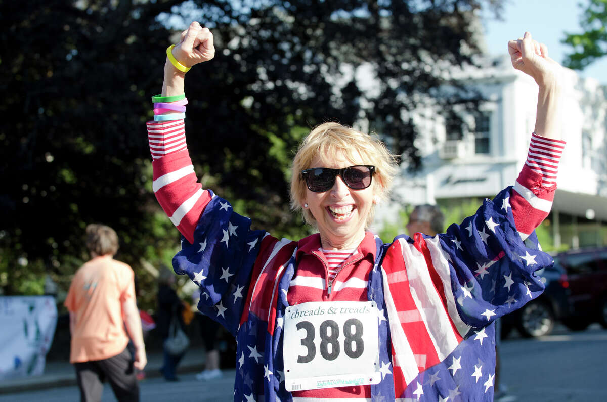 Joy Baldridge, of Stamford, gets pumped up for the annual Jim Fixx Run, a five-mile road race, on Greenwich Avenue in Greenwich on Monday, May 27, 2013.