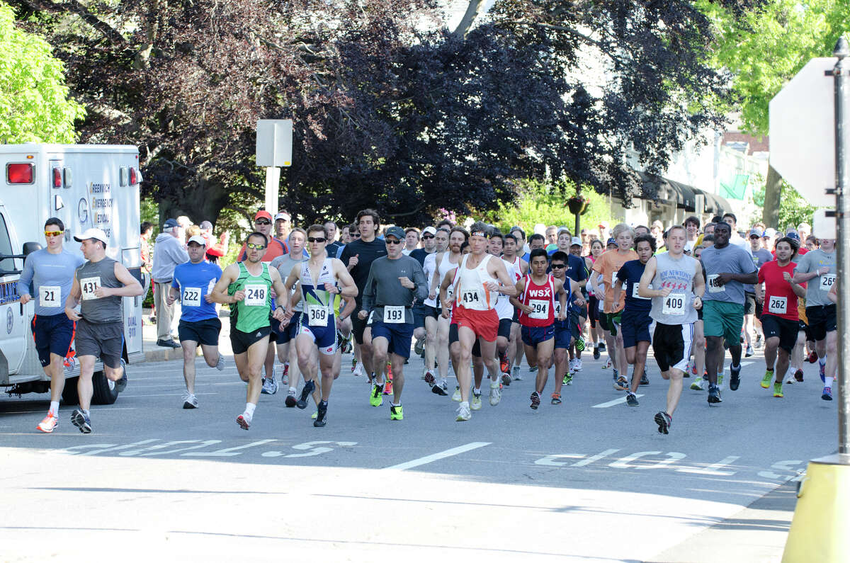 Runners take off down Greenwich Avenue during the annual Jim Fixx Run, a five-mile road race, in Greenwich on Monday, May 27, 2013.
