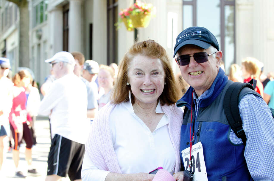 FiFi Sheridan and Paul Barbian, of Greenwich, pose for a photo during the annual Jim Fixx Run, a five-mile road race, on Greenwich Avenue in Greenwich on Monday, May 27, 2013. Photo: Amy Mortensen / Connecticut Post Freelance