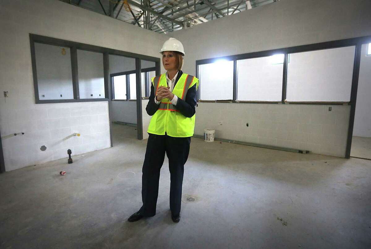 Kathy Davis, director of Animal Care Services, tours the new Paul Jolly Center for Animal Adoptions.