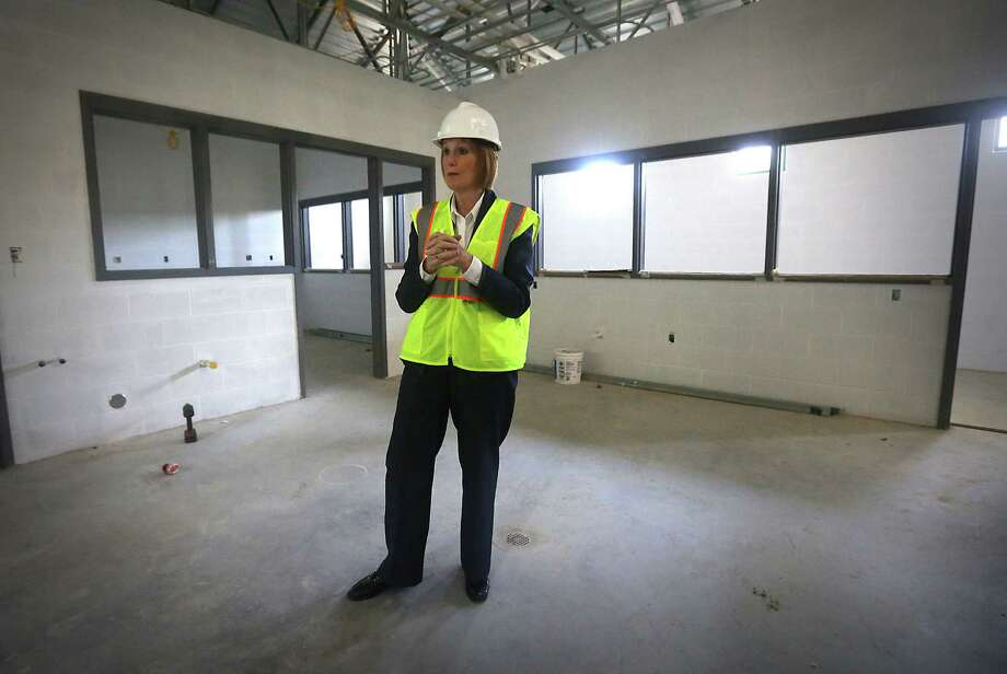 Kathy Davis, director of Animal Care Services, tours the new Paul Jolly Center for Animal Adoptions. Photo: Bob Owen, San Antonio Express-News