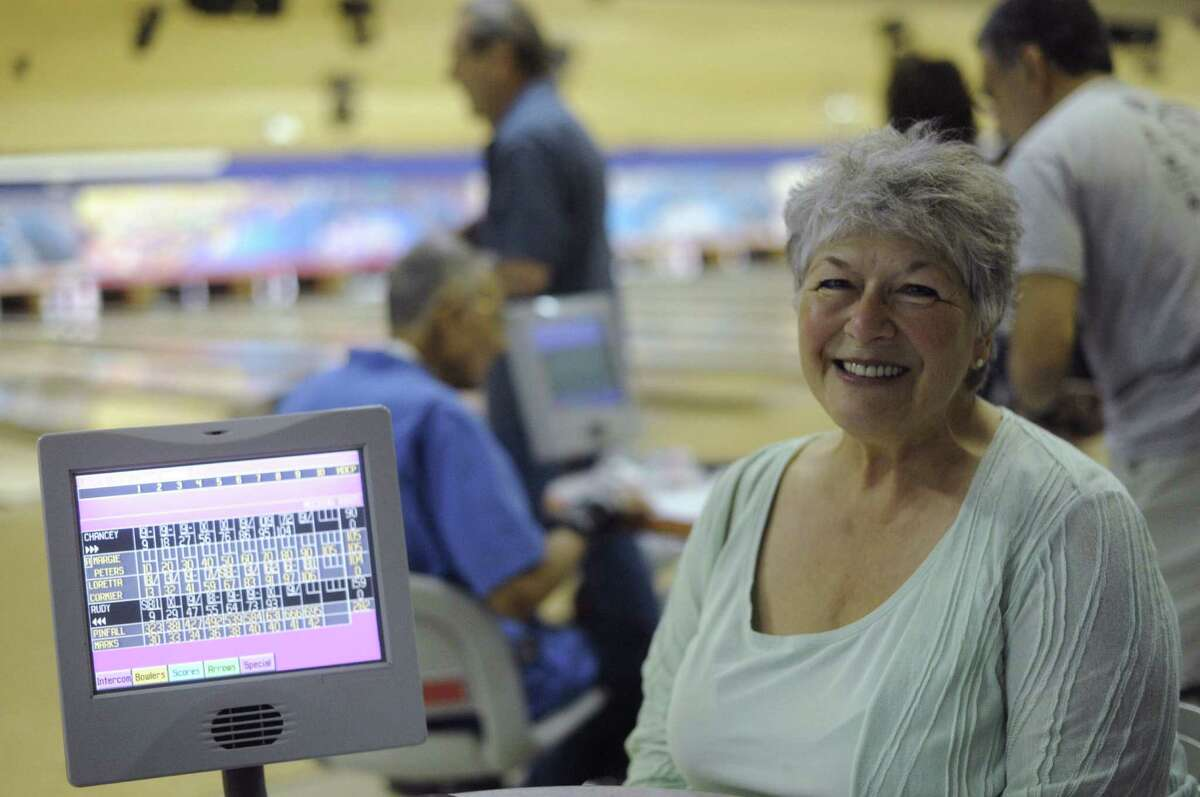 Chancey Blackburn, a widow, enjoys an afternoon of bowling. Engage in your favorite activities to meet potential dating partners with the same interests, experts recommend.