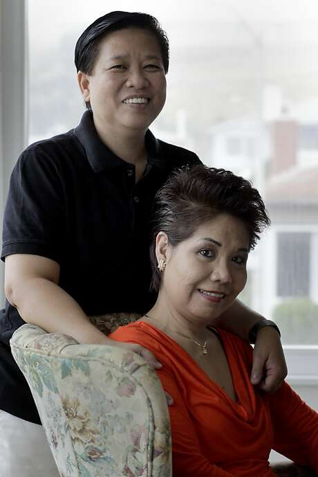 Jay Mercado (left) and Shirley Tan in their Pacifica home. Photo: Brant Ward, The Chronicle