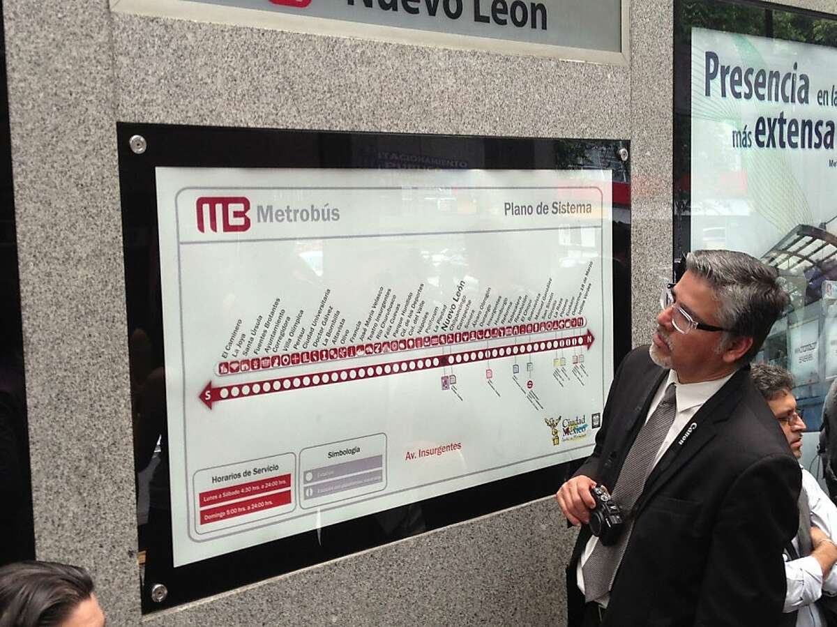 San Francisco Supervisor John Avalos looks at a Metrobus route map in Mexico City. Avalos was part of a San Francisco delegation visiting Mexico City to learn about bus rapid transit and bikesharing.