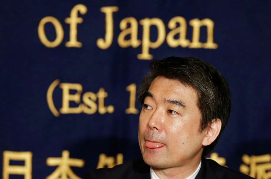 Osaka Mayor Toru Hashimoto listens to a reporter's question during a press conference at the Foreign Correspondents' Club of Japan in Tokyo Monday, May 27, 2013. The outspoken Japanese politician apologized Monday for saying U.S. troops should patronize adult entertainment businesses as a way to reduce rapes, but defended another controversial remark about Japan's use of sex slaves during World War II. (AP Photo/Shizuo Kambayashi) Photo: Shizuo Kambayashi, STF / AP