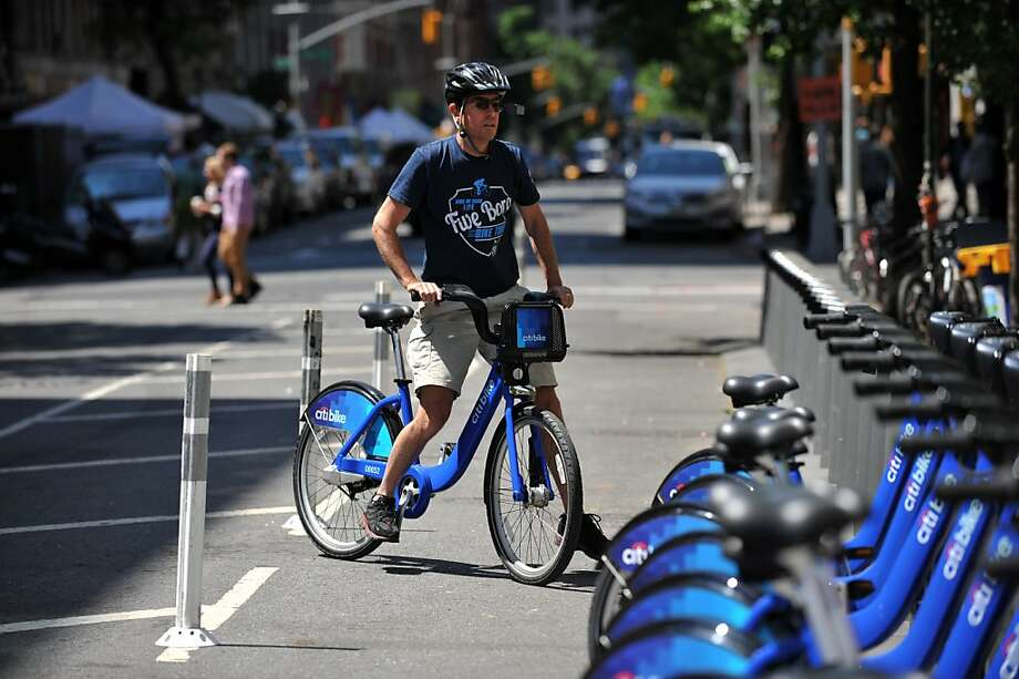 A man returns his rental ride to a station near New York City's Union Square, one of more than 300 locations in the city's new bicycle-sharing program. Plans call for an eventual 10,000 bikes at 600 stations. Photo: Stan Honda, AFP/Getty Images
