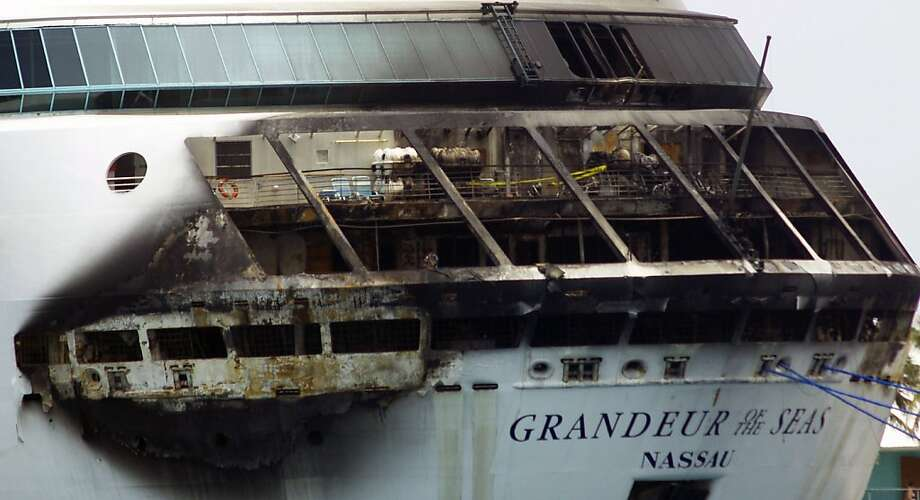 The exterior of the Royal Caribbean cruise ship shows damage from the early-morning fire. Photo: Jenneva Russell, Associated Press